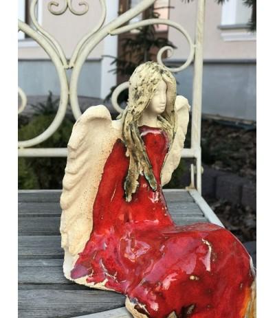 Bog.Apollo Anioł ceramiczny siedzący kolorowy